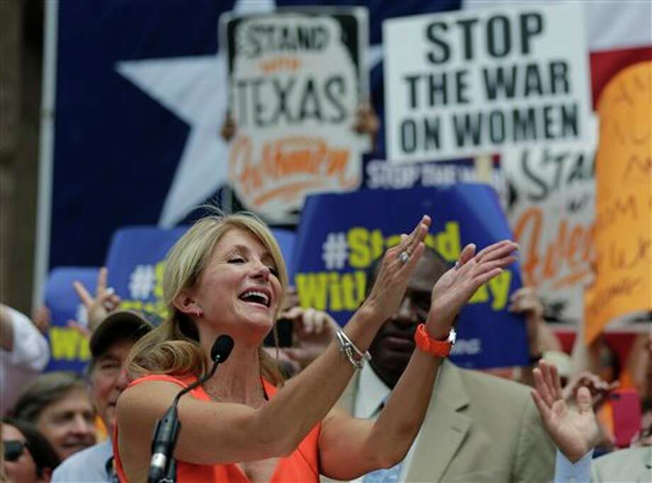 Sen. Wendy Davis, D- Fort Worth, speaks during a rally against abortion legislation, Monday, July 1, 2013, in Austin, Texas. The Texas Senate has convened for a new 30-day special session to take up contentious abortion restrictions bill and other issues. Photo: Eric Gay, AP / AP