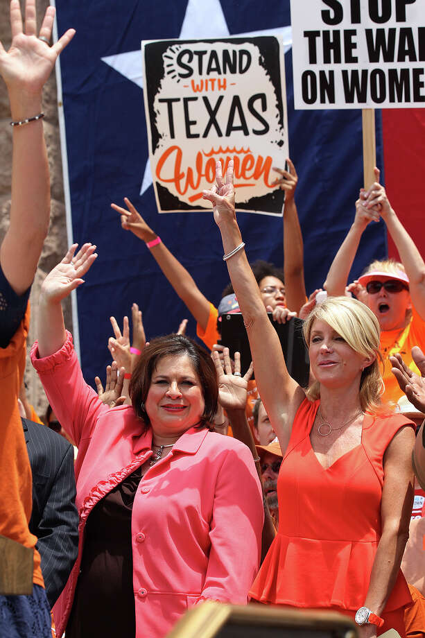 Sen. Wendy Davis, D-Fort Worth, right, and Sen. Leticia Van de Putte, D-San Antonio wave to the crowd during the Stand Up For Texas Women Rally at State Capitol, Monday, July 1, 2013. The anti-abortion legislation rally drew thousands of supporters at the start of the second legislative special session. Photo: San Antonio Express-News / ©2013 San Antonio Express-News