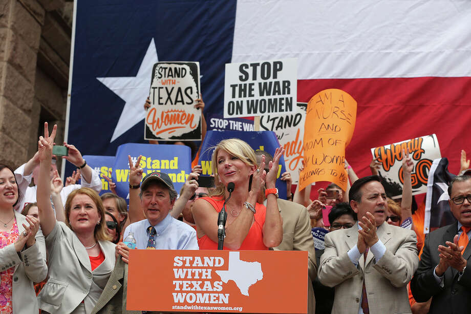 Senator Wendy Davis is the main speaker during the Stand Up With Texas Women Rally at State Capitol before the start of  the second special session, Monday, July 1, 2013. The anti-abortion legislation rally drew thousands of supporters. Photo: Jerry Lara, San Antonio Express-News / ©2013 San Antonio Express-News