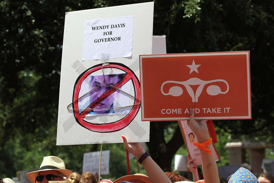 Thousands are drawn to the Stand Up With Texas Women Rally at State Capitol before the start of  the second special session, Monday, July 1, 2013. The anti-abortion legislation rally drew thousands of supporters. Photo: Jerry Lara, San Antonio Express-News / ©2013 San Antonio Express-News