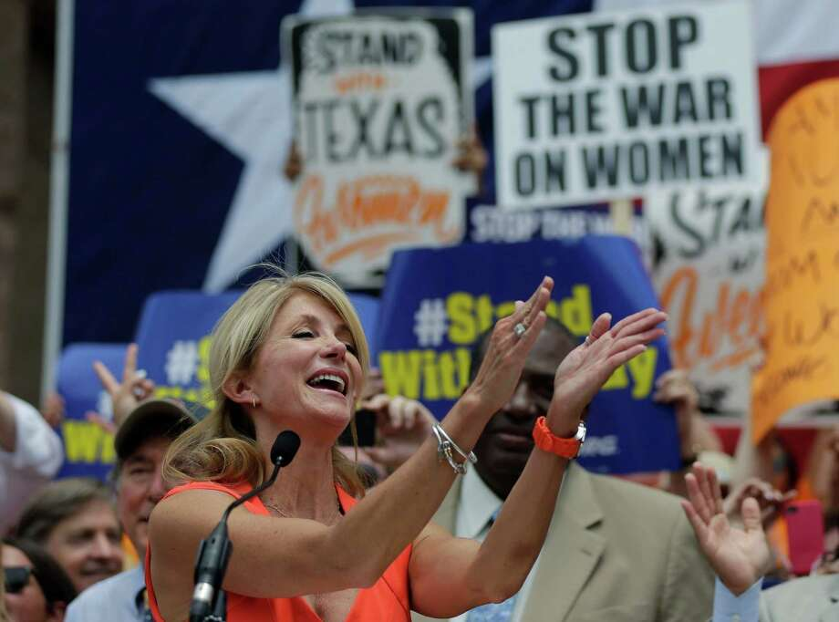 Sen. Wendy Davis, D- Fort Worth, speaks during a rally against abortion legislation, Monday, July 1, 2013, in Austin, Texas. The Texas Senate has convened for a new 30-day special session to take up contentious abortion restrictions bill and other issues. (AP Photo/Eric Gay) Photo: Eric Gay, Associated Press / AP
