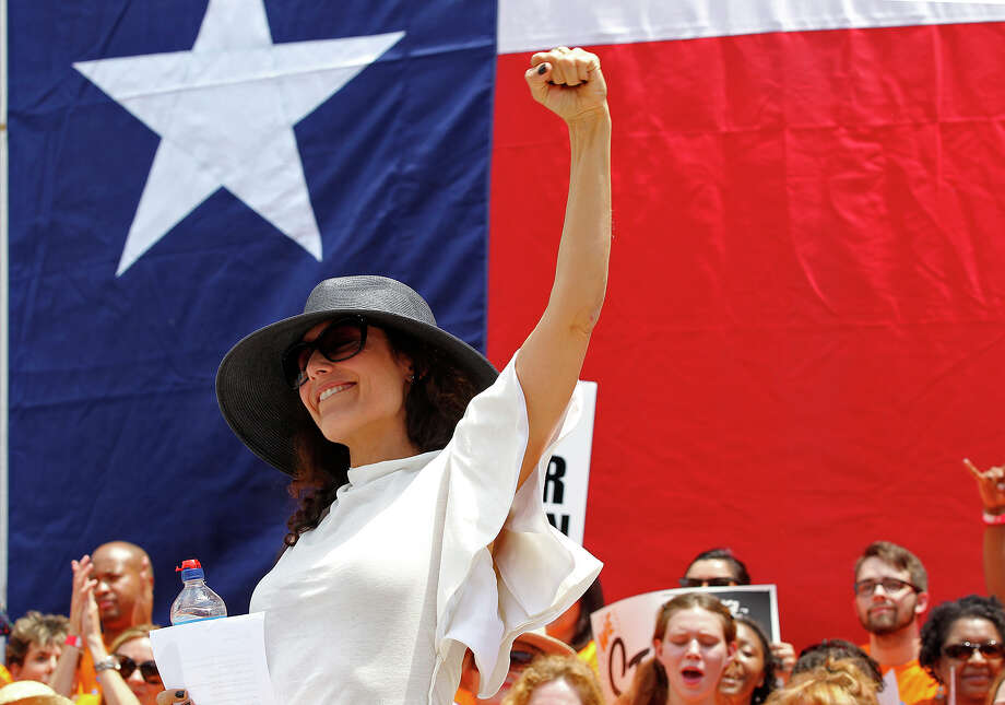 Actress Lisa Edelstein pumps up the crowd during the Stand Up For Texas Women Rally at the State Capitol, Monday, July 1, 2013. The Texas Legislature convened for a second special session to take up a controversial anti-abortion bill. Photo: Jerry Lara, San Antonio Express-News / ©2013 San Antonio Express-News