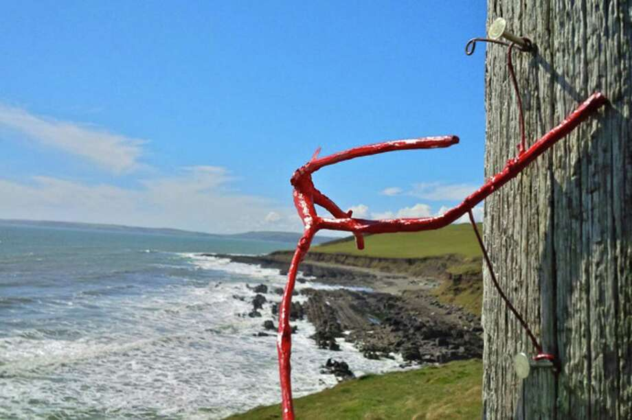 Those Red Man stick figures that have been popping up around Greenwich for some time have now started showing up in more exotic climes. Here, a Red Man makes an appearance in Ireland. Photo: Contributed Photo