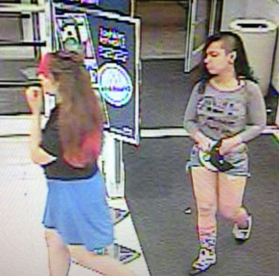 Police are searching for sisters Carmen Cotto, 16, and Angelica Cotto, 14, of Bridgeport, who were reported missing in Fairfield on Tuesday night. They are shown in this video surveillance image from the Marshall's store on the Post Road, where they were last seen, according to police. Photo: Fairfield Police Department / Fairfield Citizen