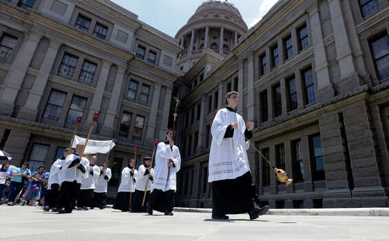 Anti-abortion supporters take part in a rosary procession around the Texas Capitol as the Texas House  debates HB 2, a bill that will place restrictions on abortion in the state, Tuesday, July 9, 2013, in Austin, Texas. (AP Photo/Eric Gay) Photo: Eric Gay, ASSOCIATED PRESS / AP2013