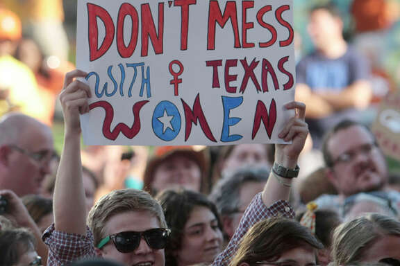 A rally partcipant holds up a sign during the Planned Parenthood Action Fund's Stand with Texas Women Rally at Discovery Green in Houston, Texas. The Rally highlighted the abortion restriction bill, House Bill 2 being Pushed in Austin Tuesday, July 9, 2013, in Houston. (AP Photo/Houston Chronicle, Billy Smith II)