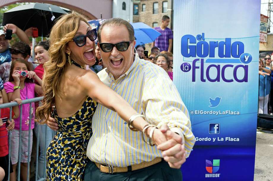 Lili Estefan (with Raul de Molina) will be hosting the night events at the Alamodome during Festival People en Español this Labor Day weekend. Photo: Getty Images