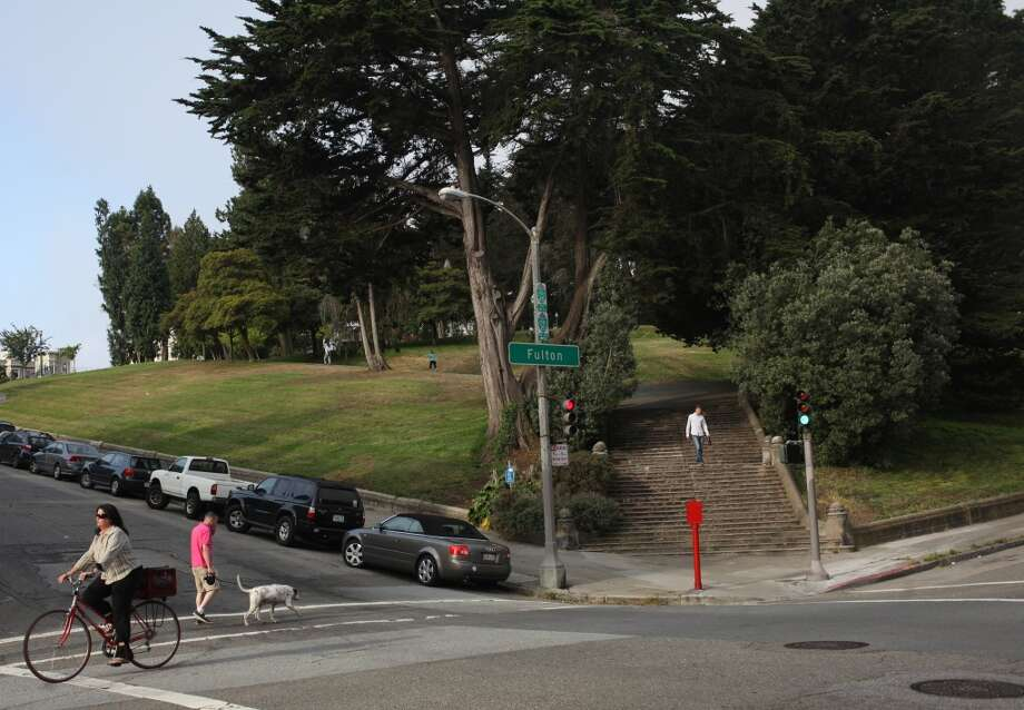 People cross Steiner Street on Fulton Street at the corner of Alamo Square on July 2, 2013 in San Francisco, Calif.