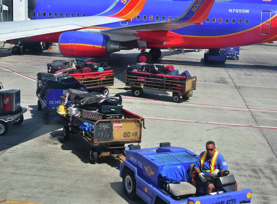 "We'll end with Southwest Airlines, which loudly boats that ""bags fly free."" That's the first two bags; additional ones cost $75 each. Southwest also charges change fee. Photo: Robert Alexander, Getty Images / 2013 Robert Alexander"