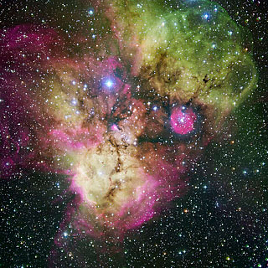 "No. 8 - ""Area surrounding the stellar cluster NGC 2467, located in the southern constellation of Puppis (""The Stern""). With an age of a few million years at most, it is a very active stellar nursery, where new stars are born continuously from large clouds of dust and gas. The image, looking like a colourful cosmic ghost or a gigantic celestial Mandrill, contains the open clusters Haffner 18 (center) and Haffner 19 (middle right: it is located inside the smaller pink region — the lower eye of the Mandrill), as well as vast areas of ionised gas. The bright star at the centre of the largest pink region on the bottom of the image is HD 64315, a massive young star that is helping shaping the structure of the whole nebular region,"" according to the European Space Observatory. Photo: ESO"