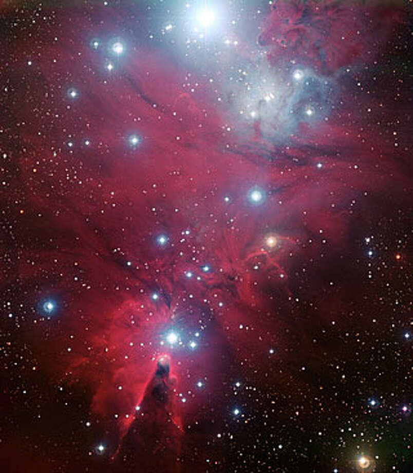 "No. 6 - ""This color image of the region known as NGC 2264 — an area of sky that includes the sparkling blue baubles of the Christmas Tree star cluster and the Cone Nebula — was created from data taken through four different filters (B, V, R and H-alpha) with the Wide Field Imager at ESO's La Silla Observatory, 2400 m high in the Atacama Desert of Chile in the foothills of the Andes. The image shows a region of space about 30 light-years across,"" according to the European Space Observatory. Photo: ESO"