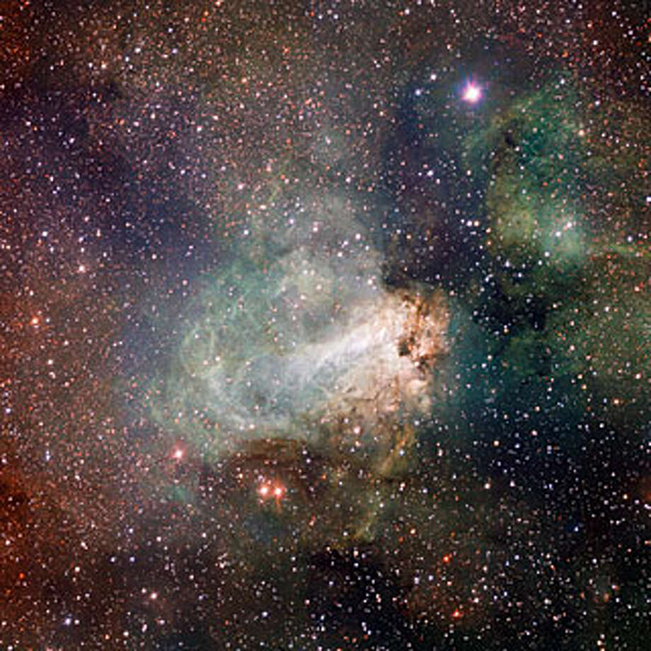 "No. 4 - ""The first released VST image shows the spectacular star-forming region Messier 17, also known as the Omega Nebula or the Swan Nebula, as it has never been seen before. This vast region of gas, dust and hot young stars lies in the heart of the Milky Way in the constellation of Sagittarius (The Archer). The VST field of view is so large that the entire nebula, including its fainter outer parts, is captured — and retains its superb sharpness across the entire image. The data were processed using the Astro-WISE software system developed by E.A. Valentijn and collaborators at Groningen and elsewhere,"" according to the European Space Observatory. Photo: ESO"