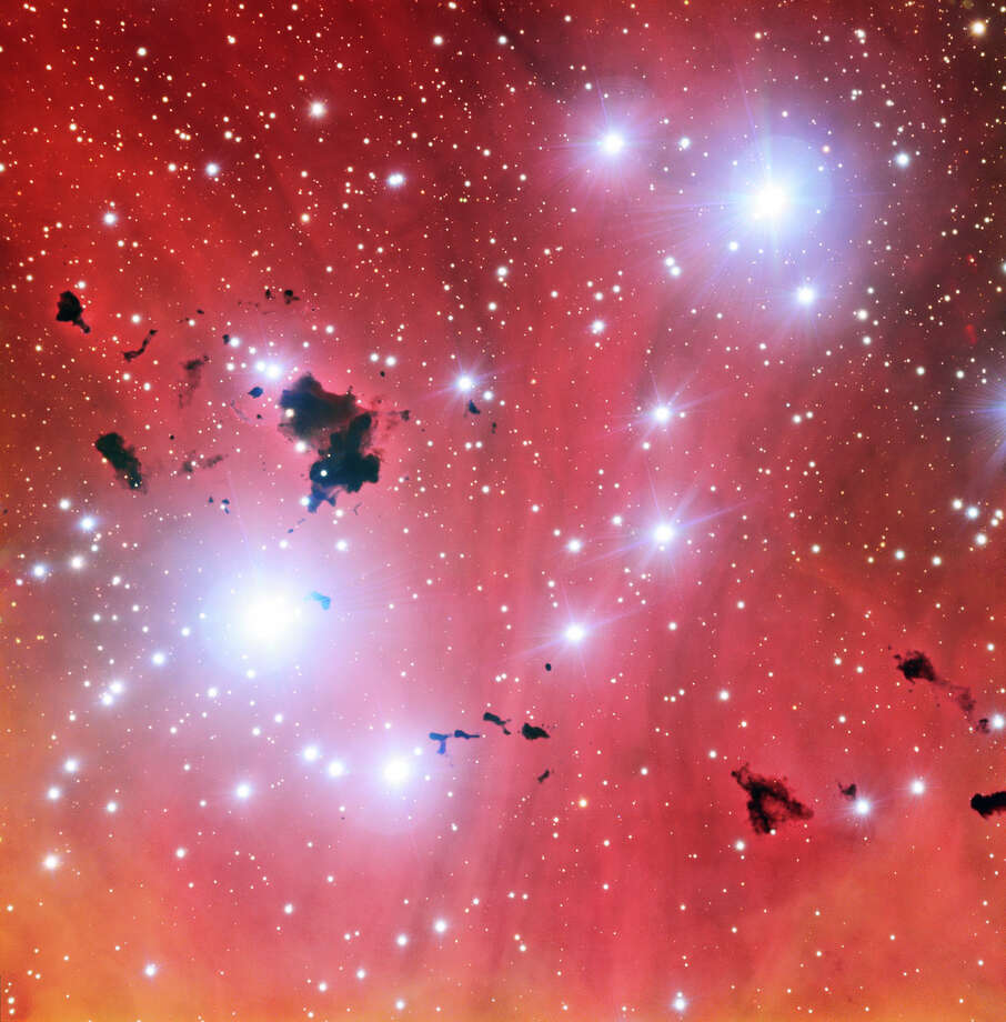 "No. 1 - ""This intriguing new view of a spectacular stellar nursery IC 2944 is being released to celebrate a milestone: 15 years of ESO's Very Large Telescope. This image also shows a group of thick clouds of dust known as the Thackeray globules silhouetted against the pale pink glowing gas of the nebula. These globules are under fierce bombardment from the ultraviolet radiation from nearby hot young stars. They are both being eroded away and also fragmenting, rather like lumps of butter dropped onto a hot frying pan. It is likely that Thackeray's globules will be destroyed before they can collapse and form new stars,"" according to the European Space Observatory. Photo: ESO"