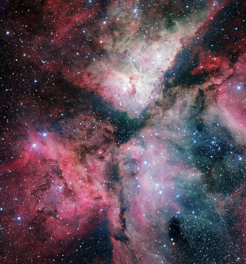 """No. 10 - """"This spectacular panoramic view combines a new image of the field around the Wolf–Rayet star WR 22 in the Carina Nebula (right) with an earlier picture of the region around the unique star Eta Carinae in the heart of the nebula (left). The picture was created from images taken with the Wide Field Imager on the MPG/ESO 2.2-meter telescope at ESO's La Silla Observatory in Chile,"""" according to the European Space Observatory. Photo: ESO"""