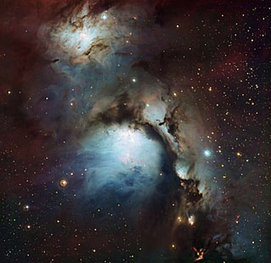 "No. 14 - ""This new image of the reflection nebula Messier 78 was captured using the Wide Field Imager camera on the MPG/ESO 2.2-meter telescope at the La Silla Observatory, Chile. This color picture was created from many monochrome exposures taken through blue, yellow/green and red filters, supplemented by exposures through a filter that isolates light from glowing hydrogen gas. The total exposure times were 9, 9, 17.5 and 15.5 minutes per filter, respectively,"" according to the European Space Observatory. Photo: ESO"