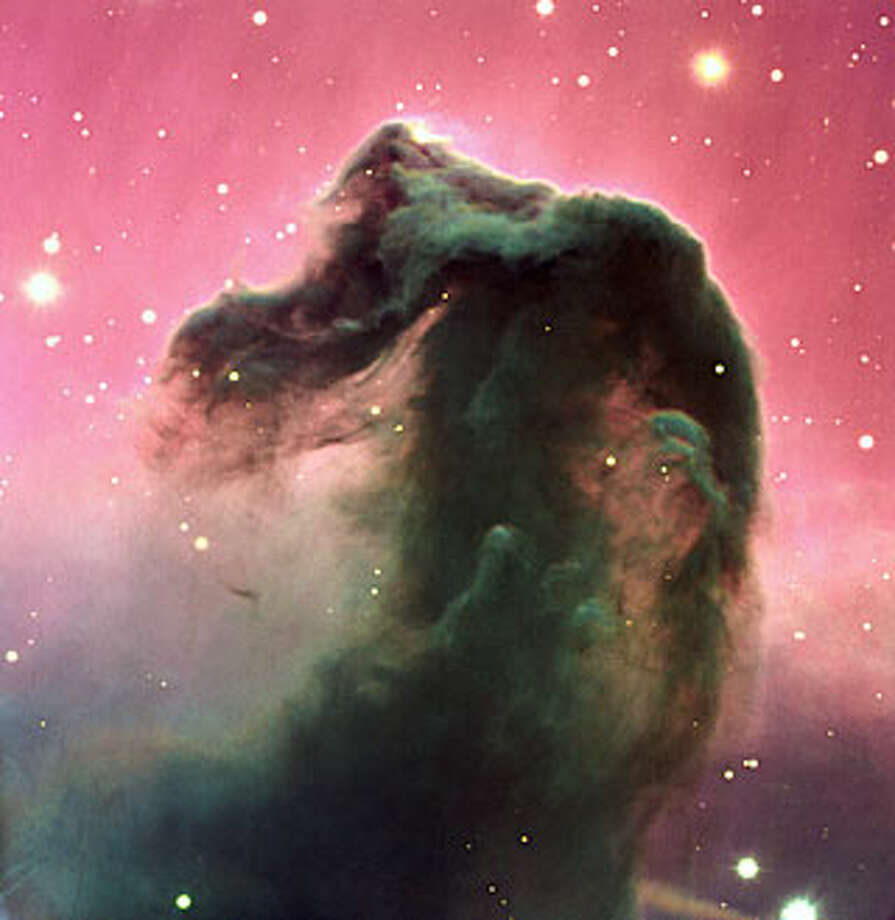 "No. 9 - ""A reproduction of a composite color image of the Horsehead Nebula and its immediate surroundings. It is based on three exposures in the visual part of the spectrum with the FORS2 multi-mode instrument at the 8.2-m KUEYEN telescope at Paranal. It was produced from three images, obtained on February 1, 2000, with the FORS2 multi-mode instrument at the 8.2-m KUEYEN Unit Telescope and extracted from the VLT Science Archive Facility . The frames were obtained in the B-band (600 sec exposure; wavelength 429 nm; FWHM 88 nm; here rendered as blue), V-band (300 sec; 554 nm; 112 nm; green) and R-band (120 sec; 655 nm; 165 nm; red). The original pixel size is 0.2 arcsec. The photo shows the full field recorded in all three colors, approximately 6.5 x 6.7 arcmin 2 . The seeing was about 0.75 arcsec,"" according to the European Space Observatory. Photo: ESO"