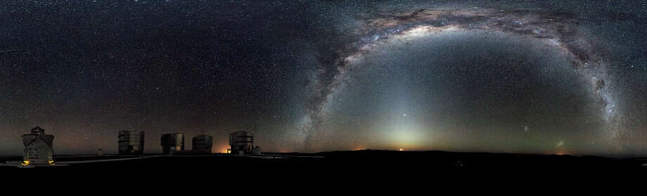 "No. 18 - ""The Milky Way arches across this rare 360-degree panorama of the night sky above the Paranal platform, home of ESO's Very Large Telescope. The image was made from 37 individual frames with a total exposure time of about 30 minutes, taken in the early morning hours. Themoon is just rising and the zodiacal light shines above it, while the Milky Way stretches across the sky opposite the observatory.