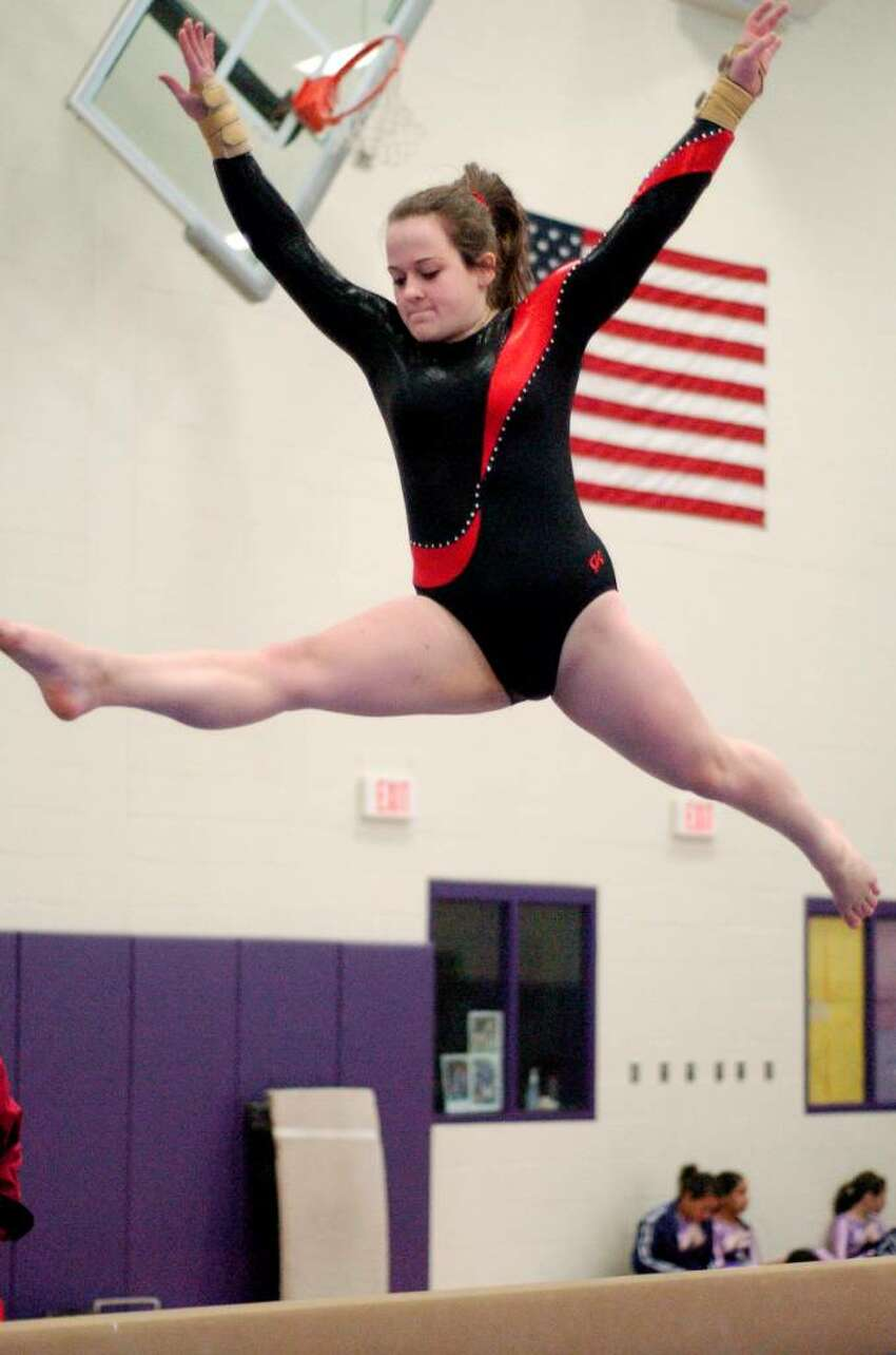 Jaclyn Golet from Pomperaug competes at gymnastics meet at Westhill High School in Stamford, Conn. on Monday January 18, 2010. Westhill and Pomperaug are two of the schools competing.