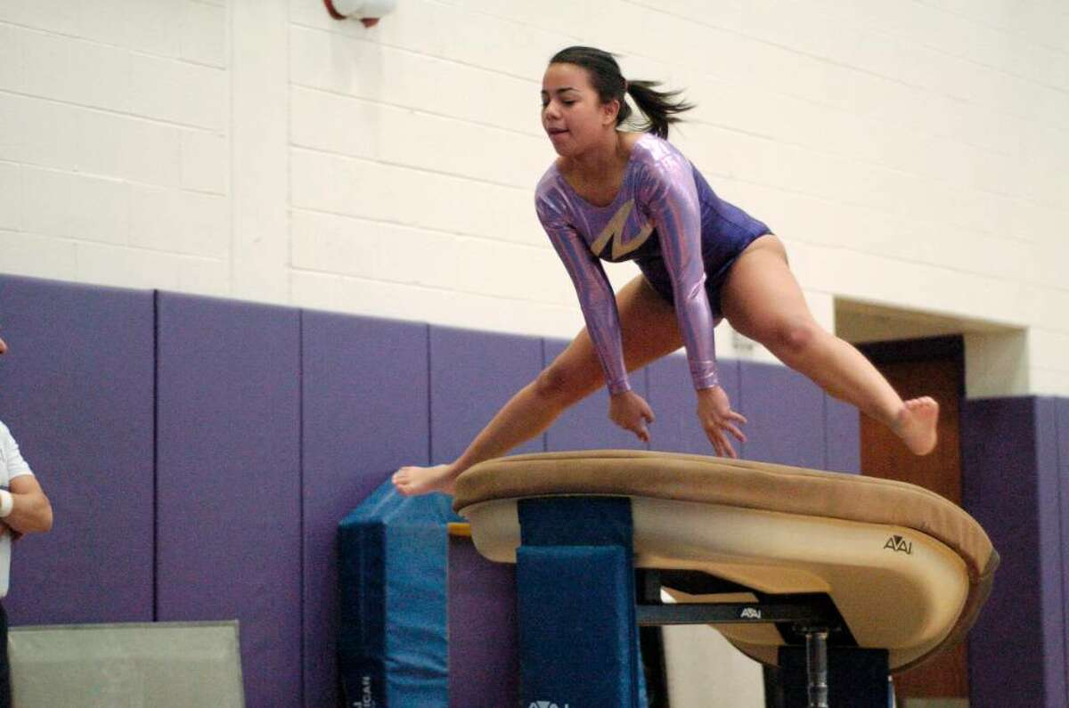 Melissa Mejia from Westhill competes at the gymnastics meet at Westhill High School in Stamford, Conn. on Monday January 18, 2010. Westhill and Pomperaug are two of the schools competing.