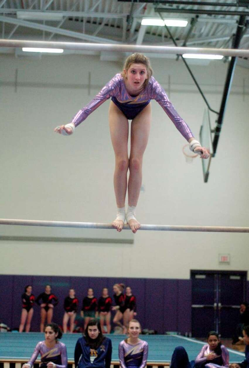 Christina Zendman from Westhill High School competes at gymnastics meet at Westhill High School in Stamford, Conn. on Monday January 18, 2010. Westhill and Pomperaug are two of the schools competing.