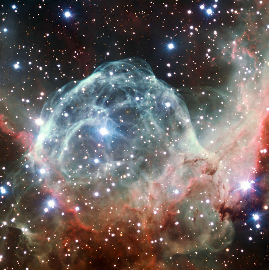 "Starting at No. 30 and working our way to the ESO's top pick - ""This VLT image of the Thor's Helmet Nebula was taken on the occasion of ESO's 50th Anniversary, Oct. 5, 2012, with the help of Brigitte Bailleul — winner of the Tweet Your Way to the VLT! competition. The observations were broadcast live over the internet from the Paranal Observatory in Chile. This object, also known as NGC 2359, lies in the constellation of Canis Major (The Great Dog). The helmet-shaped nebula is around 15 000 light-years away from Earth and is over 30 light-years across. The helmet is a cosmic bubble, blown as the wind from the bright, massive star near the bubble's centre sweeps through the surrounding molecular cloud,"" according to the European Space Observatory.  Photo: ESO"