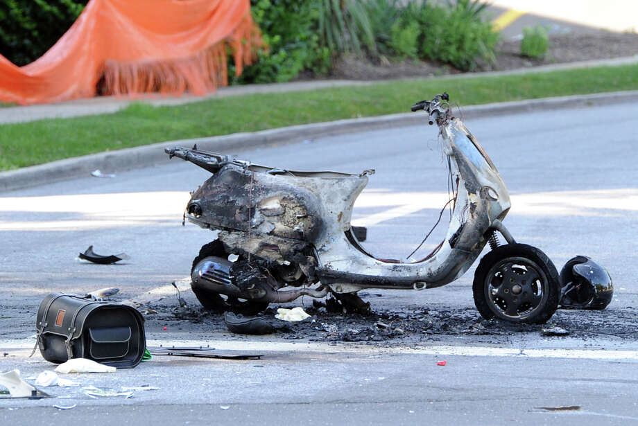The scene of an accident in which a scooter was incinerated at the corner of Valley Drive and West Putnam Avenue in Western Greenwich, Friday, July 5, 2013. Photo: Bob Luckey / Greenwich Time