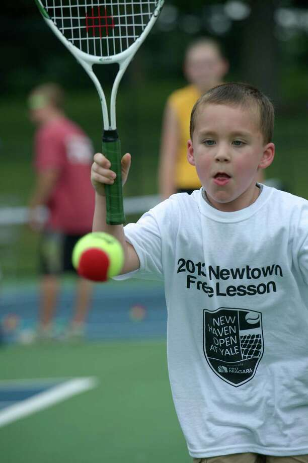 Connor chases a ball during a tennis clinic, hosted by the New Haven Open tennis tournament, at Dickerson Park in Newtown, Conn, for Newtown Park & Recreation summer campers on Wednesday July 10, 2013. Photo: H John Voorhees III
