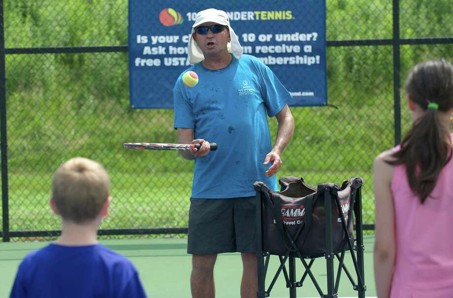 Jacob Kreimer, from Fairfield County Tennis, was one of the instructors at a tennis clinic for Newtown Conn Park & Recreation summer campers on Wednesday July 10, 2013. Photo: H John Voorhees III