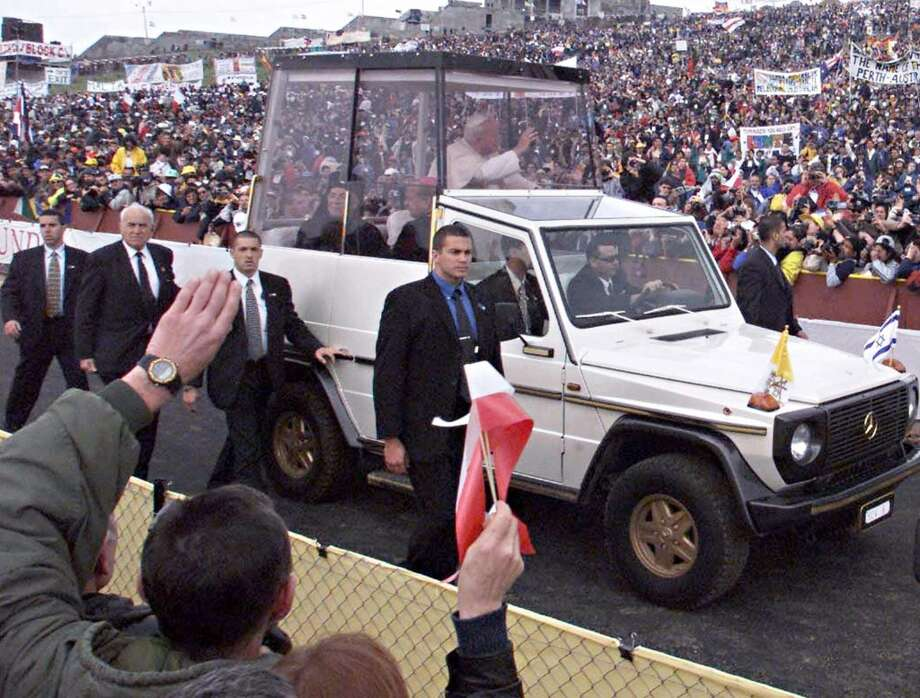 A picture taken on March 24, 2000 shows late Pope John Paul II arriving in Korazim by the Sea of Galilee in his bullet-proof popemobile to celebrate a mass in front of some 100,000 people on the Mount of the Beatitudes. Israel rolls out the red carpet for Pope Benedict XVI next week, but the German pontiff is unlikely to be greeted with the same warmth enjoyed by his predecessor on his landmark trip nine years ago. The pontiff arrives in Israel from Jordan on May 11, 2009 for a five-day pilgrimage that will see him follow in the footsteps of Jesus and visit Jewish and Muslim holy sites in Israel and the occupied West Bank.