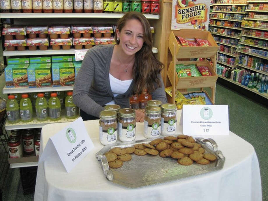 Kristin Farrell of In a Jar Foods sets up shop in stores promoting her product: Pre-packaged dry ingredients for chocolate chip and oatmeal raisin cookies. Photo: Contributed