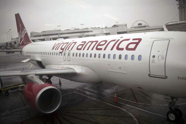 LOS ANGELES - MARCH 25: A Virgin America Airbus 320 jet is parked at a ramp March 25, 2012 at the Los Angeles Airport, LAX, in Los Angeles, California. Headquartered in Burlingame, California, Virgin America was created and is owned by Sir Richard Branson, the British entrepreneur.