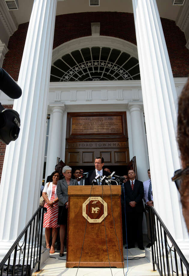 Governor Dannel Malloy speaks to the media in front of Milford Town Hall about the recent neighborhood watch leaflets left by the United Klans of America, in downtown Milford, Conn. on Wednesday July 10, 2013. Photo: Christian Abraham / Connecticut Post