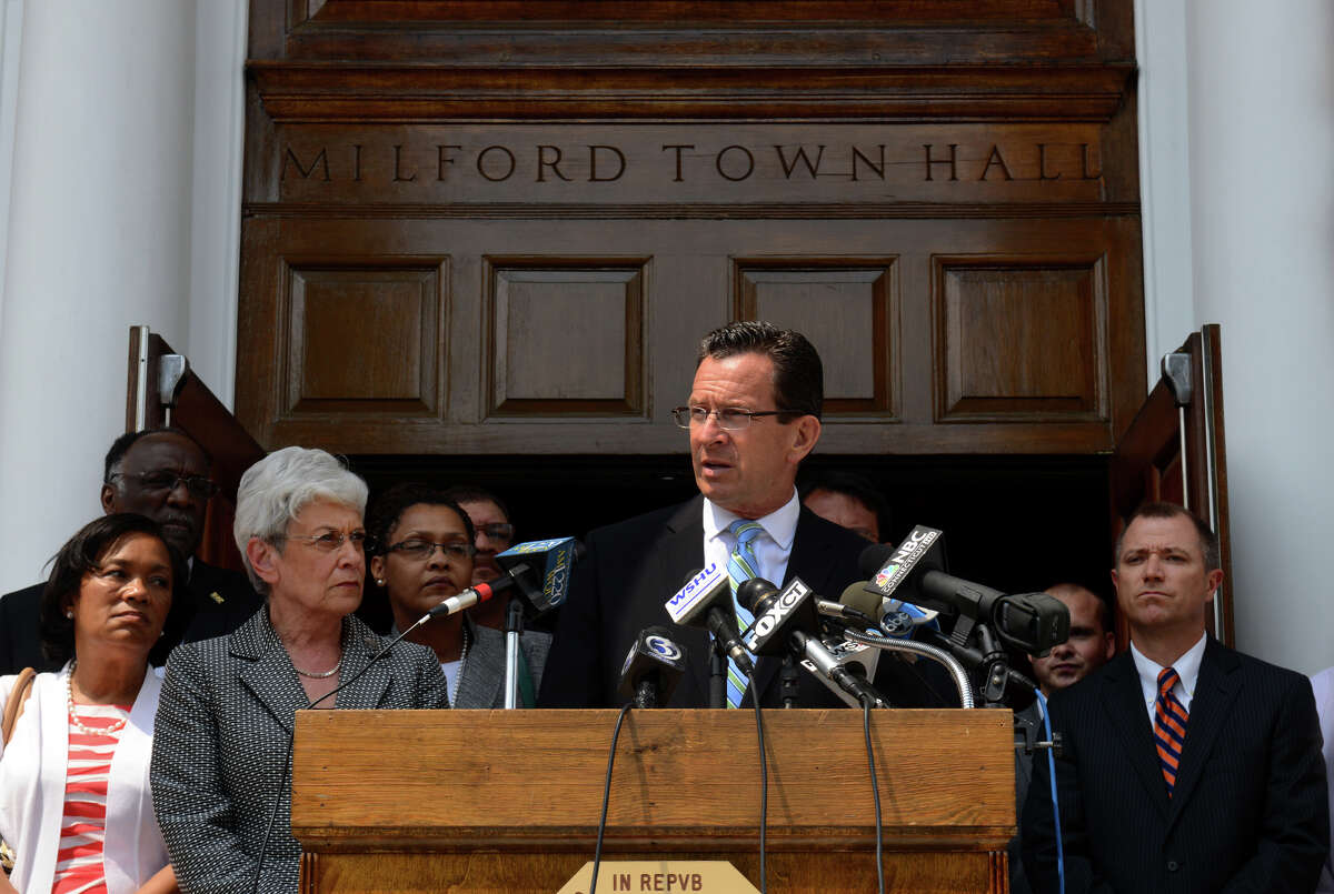 Governor Dannel Malloy speaks to the media in front of Milford Town Hall about the recent neighborhood watch leaflets left by the United Klans of America, in downtown Milford, Conn. on Wednesday July 10, 2013.