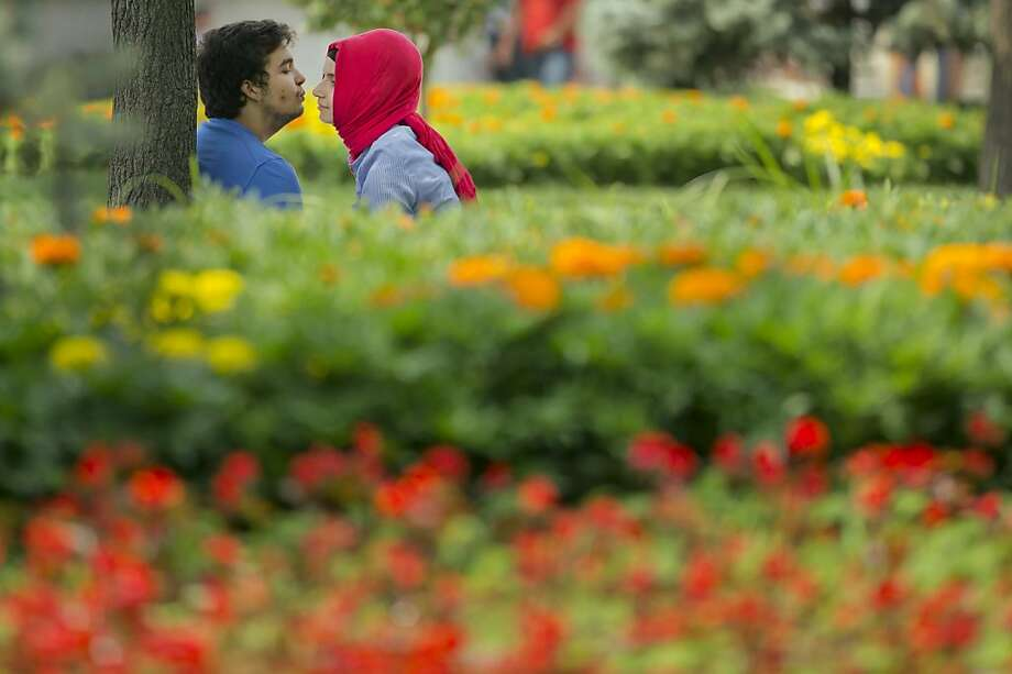 Love blossoms as Gezi Park in Istanbul, the center of the anti-government protests, reopens to the public. Photo: Vadim Ghirda, Associated Press