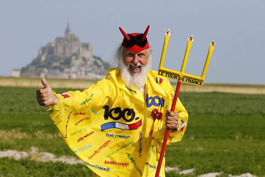 Going my way? Don't pick up hitchhikers along the Tour de France route, especially not this guy. He'll try to sell you a time share. (Tenth stage, Mont-Saint-Michel.) Photo: Joel Saget, AFP/Getty Images