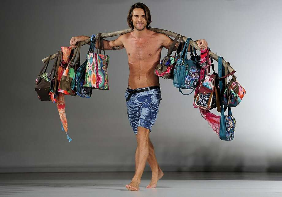 Bag man: A model over-accessorizes for the Desigual collection during the 080 Barcelona fashion show in Barcelona. Photo: Josep Lago, AFP/Getty Images