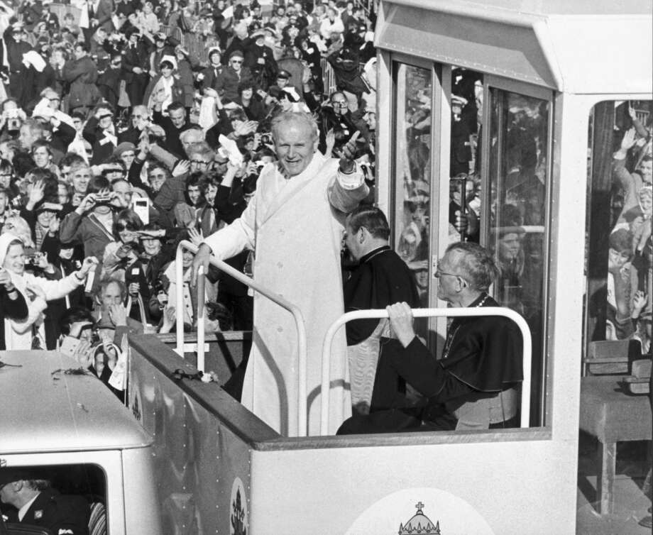 "John Paul II (1920-2005) in his ""Popemobile"", waves to the huge crowds who turned out  greet him during his visit to Ireland."