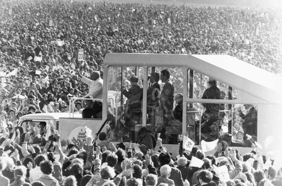 "John Paul II (1920-2005) in his ""popemobile"", waves to the huge crowds who turned out to greet him during his visit to Ireland on September 29, 1979."