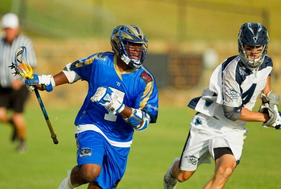 """Professional lacrosse player Jovan Miller (pictured) boycotted the Warrior lacrosse equipment company after it created a t-shirt reading """"Ninja Please,"""" which Miller found offensive."""