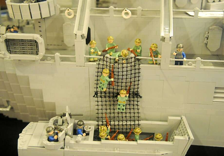 LEGO Leathernecks:LEGO Marines climb down from a LEGO LST ship to a landing craft before hitting the beach on a LEGO Island of Peleliu and presumably rooting out LEGO Japanese in LEGO caves. The diorama of the World War II battle was built by Brickmania, a seller of custom LEGO sets, in Evansville, Ind. Photo: Erin McCracken, Associated Press