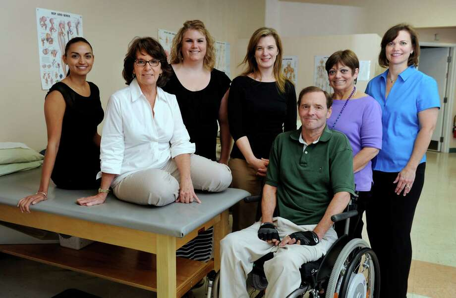 Rick Carlson, founder and owner of Carlson Physical Therapy, is photographed with the staff of his Ridgefield office Wednesday, July 10, 2013. From the left are Anastasia Thomson, Joanne Sullivan, Crystal Madyda, Melissa Hackett, Rick Carlson, Kay Ullman and Gail Fennell. Photo: Carol Kaliff / The News-Times