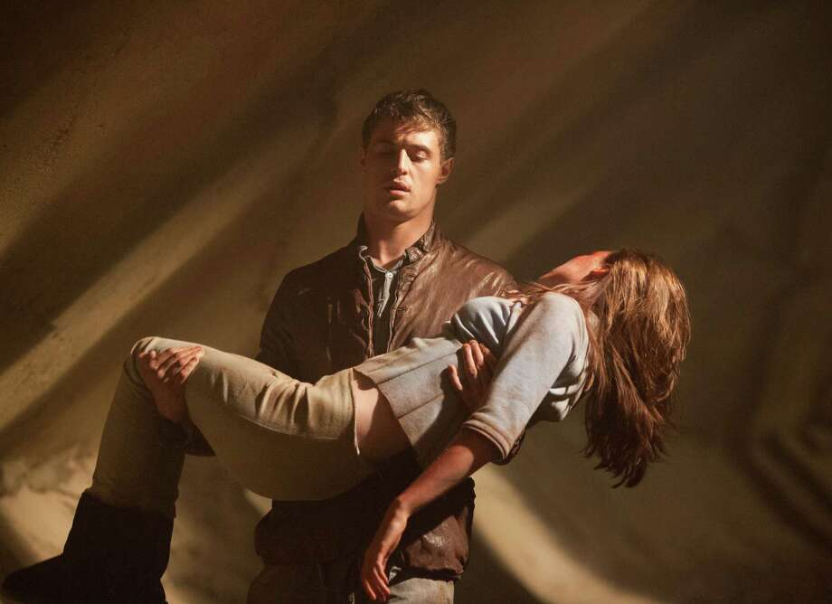 """This film image released by Open Road Films shows Max Irons and Saoirse Ronan in a scene from """"The Host."""" (AP Photo/Open Road Films, Alan Markfield) Photo: Alan Markfield / Open Road Films"""