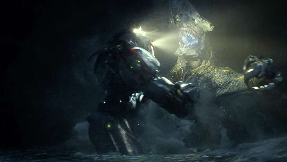 "This film publicity image released by Warner Bros. Pictures shows the Gipsy Danger robot battling the Knifehead monster in a scene from ""Pacific Rim.""   (AP Photo/Warner Bros. Pictures) ORG XMIT: NYET104 Photo: Uncredited / Warner Bros. Pictures"