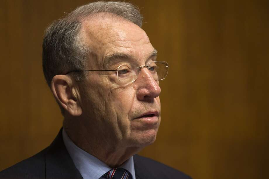 Sen. Chuck Grassley, R-Iowa, ranking Republican on the Senate Judiciary Committee, questions B. Todd Jones of Minnesota, President Barack Obama's nominee for director of the Bureau of Alcohol, Tobacco, Firearms and Explosives, during the committee's hearing on Jones' nomination, Tuesday, June 11, 2013, on Capitol Hill in Washington.