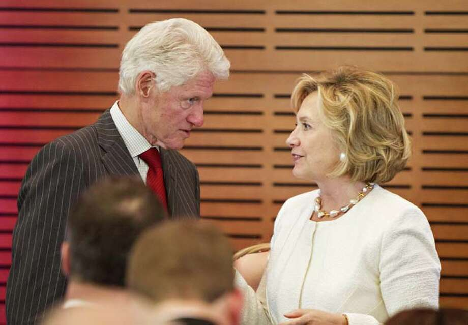 LITTLE ROCK, AR - JULY 08: Former President Bill Clinton and Hillary Rodham Clinton attend the Oscar de la Renta: American Icon reception at the William J. Clinton Presidential Center on July 08, 2013 in Little Rock, Arkansas. Photo: Wesley Hitt, Getty Images / 2013 Getty Images