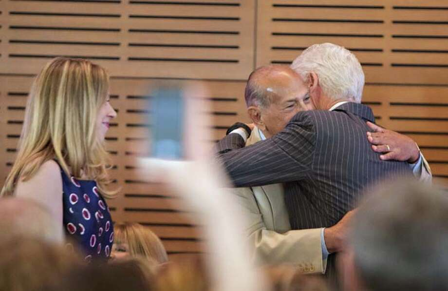 LITTLE ROCK, AR - JULY 08: Chelsea Clinton watches as President Bill Clinton and Oscar de la Renta hug during the Oscar de la Renta: American Icon reception at the William J. Clinton Presidential Center on July 08, 2013 in Little Rock, Arkansas. Photo: Wesley Hitt, Getty Images / 2013 Getty Images