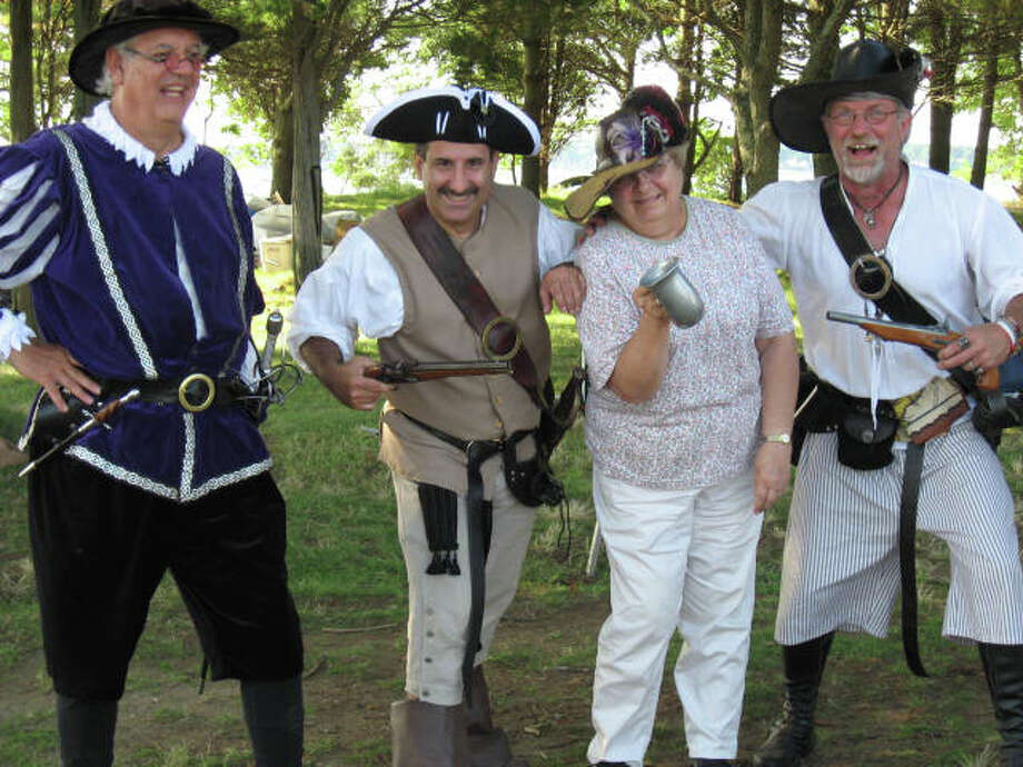 "The Norwalk Seaport Association celebrates Pirates Weekend Saturday and Sunday, July 20-21, on Sheffield Island. Among the ""invaders"" will be, from left, Larry ""Count  Carpaccio"" Senner; ""Pistol Pete"" Bondi; Pauline Schlegel; and Ned ""Dead Eye"" Koselek. Photo: Contributed Photo"