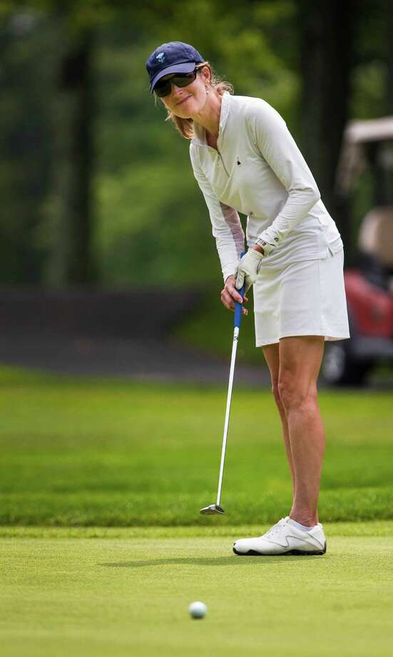 Annesley MacFarlane putts on the 18th green during the Greenwich Women's Town Golf Championship held at Griffith E. Harris Golf Course, Greenwich CT on Wednesday July 10th, 2013. Photo: Mark Conrad / Stamford Advocate Freelance