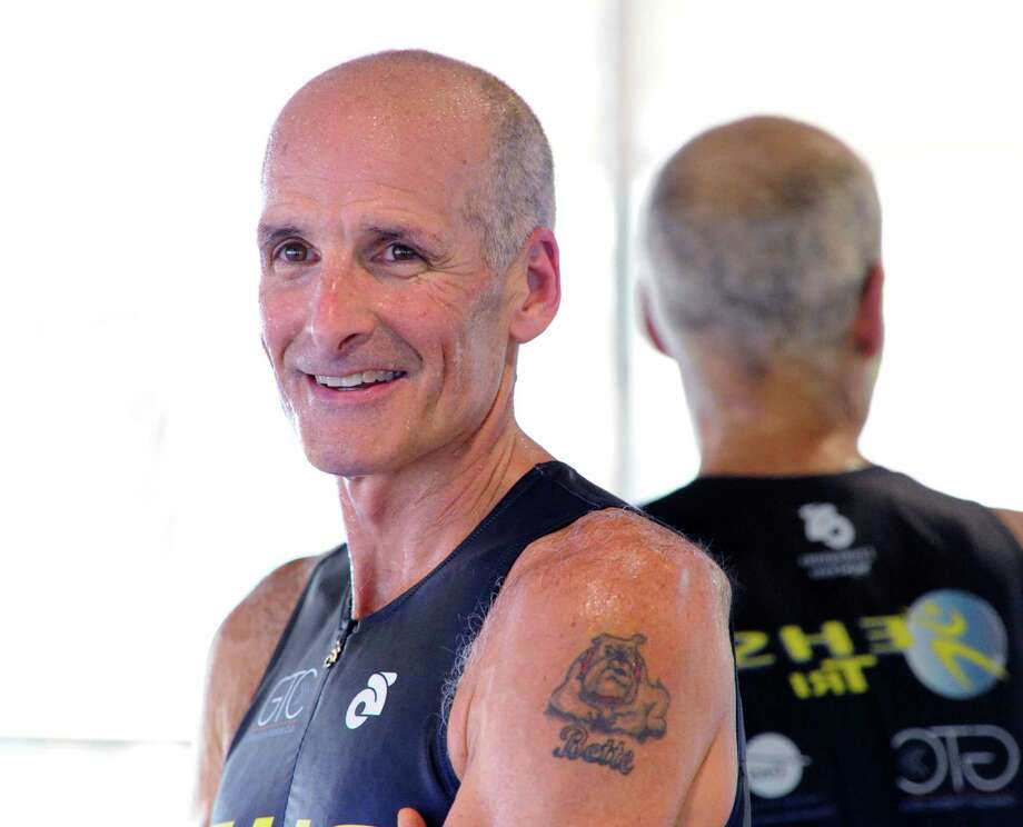Triathlete , Mike Christie, 56, of Cos Cob, at Elite Health Services in Greenwich where he is a coach, Wednesday, July 10, 2013. Christie placed 1st in his division (age group 55-59) at Ironman Couer d'Alene on June 23rd. Christie completed the event in 10:42:31, winning his division and earning a qualifying spot in the Ironman World Championship in Kona Hawaii on October 12th. Photo: Bob Luckey / Greenwich Time