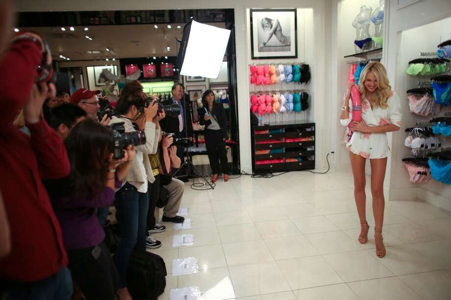 Supermodel Candice Swanepoel poses for photographers.